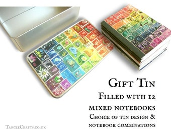 Notebook gift set in storage tin | 12 pocket size travel notebooks, ruled undated journal pages, recycled paper | stamp collector stationery