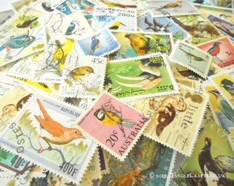 40 or 80 bird theme world postage stamps (loose in packet)