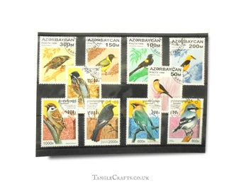 Garden Birds on Postage Stamps - part sets from Azerbaijan & Cambodia