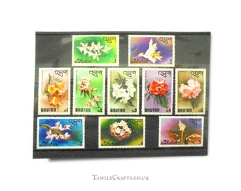 Floral postage stamps from 2 different part sets - Bhutan, 1976