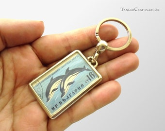 Stylised Dolphin Keyring - upcycled 1961 postage stamp from Bulgaria