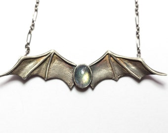 Silver Bat Wings Necklace with Oval Labradorite Cabochon Nestled Inside