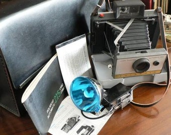 vintage camera ...  the POLAROID model 215 LAND CAMERA  ...