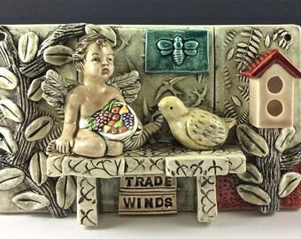 Ceramic art Tile, Trade Winds, Cherub with Cornucopia, Bird and Birdhouse