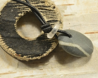 Mr. Stripey.. a natural Maine super smooth grey  sea /beach stone adjustable unisex necklace  on a leather cord with a white trade bead