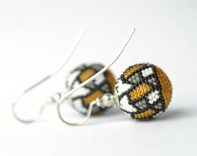 globe earrings silver with graphic ornament