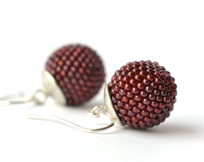 silver earrings dark red glass beads globe dangle earrings by donauluft