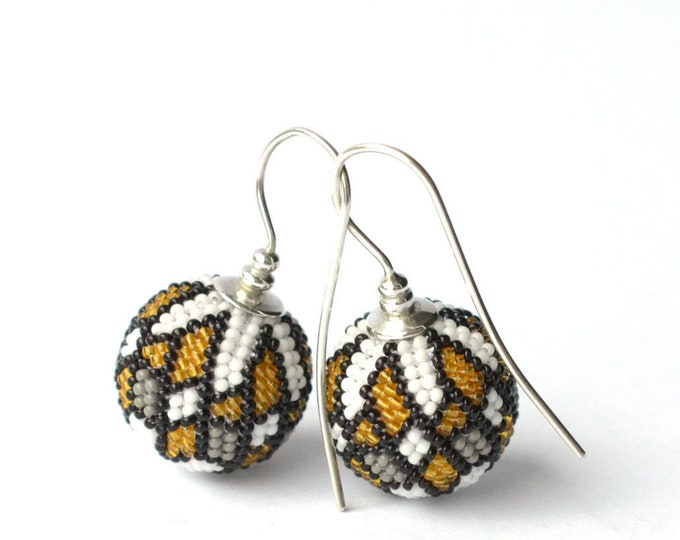 globe earrings with graphic ornament