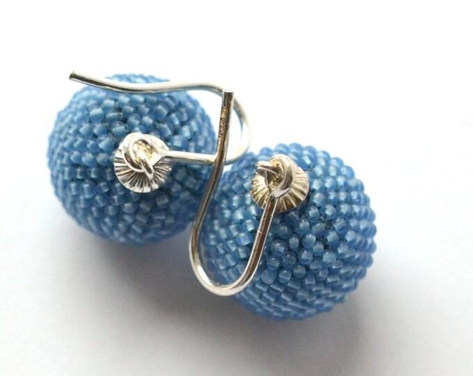 beaded globe earrings light blue