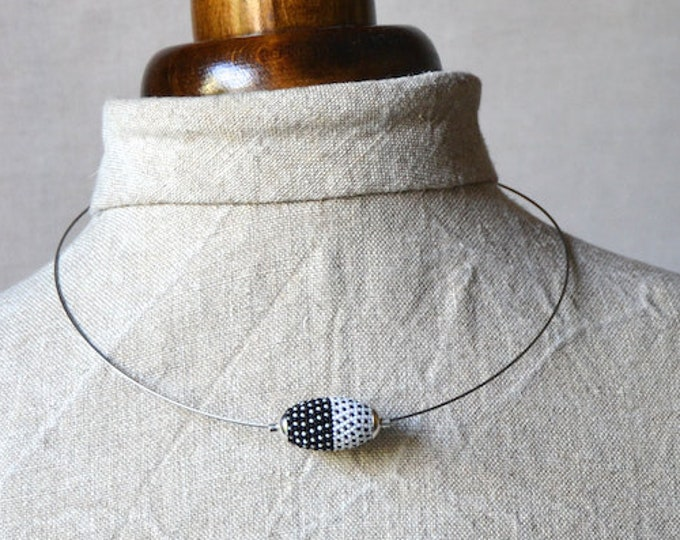 beaded pendant  with stainless steel necklace and silver in black and white