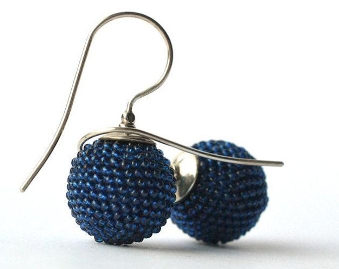 beaded globe earrings dark blue