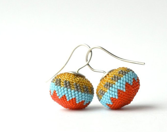dangle earrings ethno style tuquoise orange from glass beads and silver hooks
