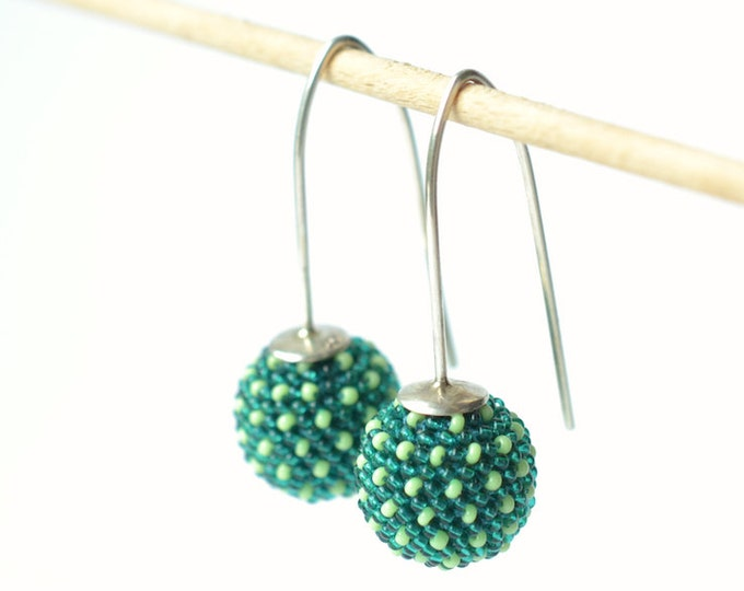 earrings green globes with dots dangle earrings long glass beads silver hooks