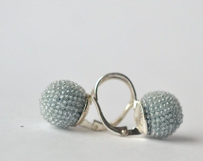 globe earrings light blue