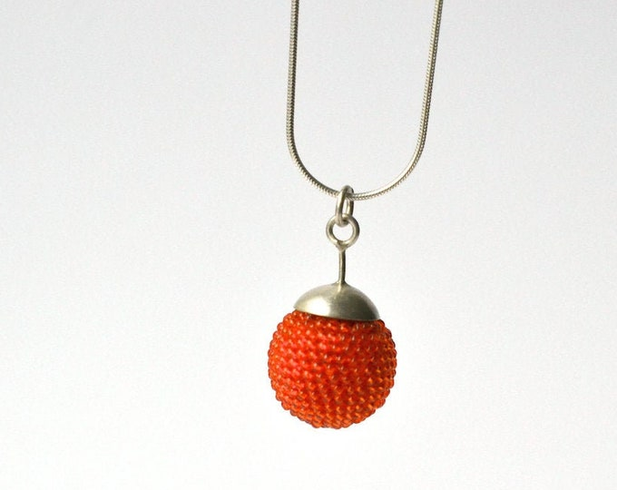 pendant with silver necklace orange