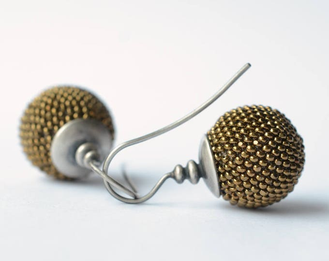 globe earrings with antique touch