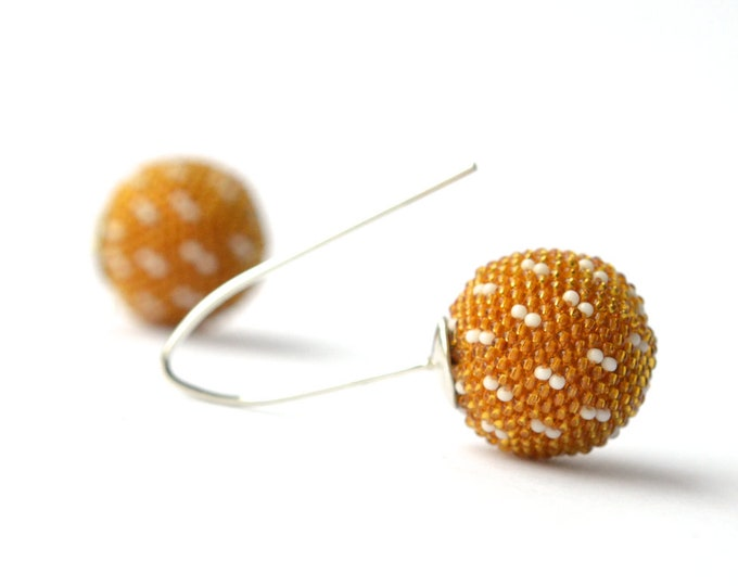globe earrings yellow sashiko style