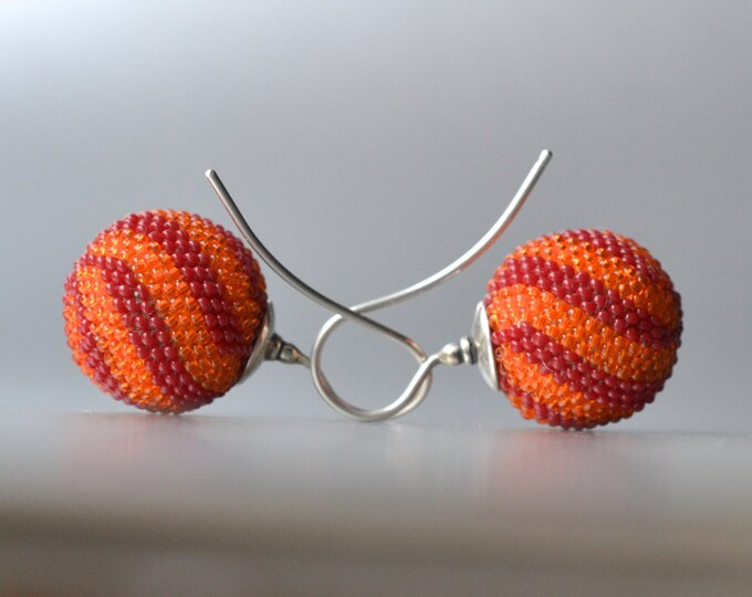 globe earrings rot orange  twisted