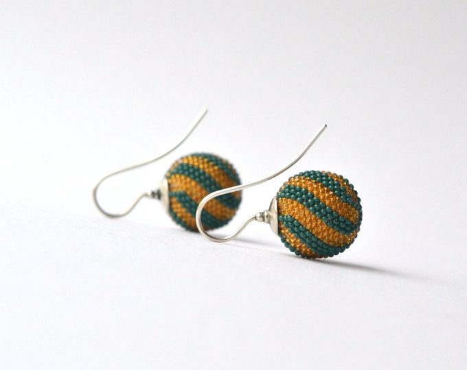 globe earrings green mustard  twisted