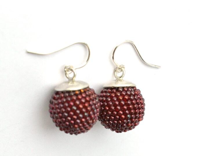silver earrings dark red glass beads globe dangle earrings by donauluft