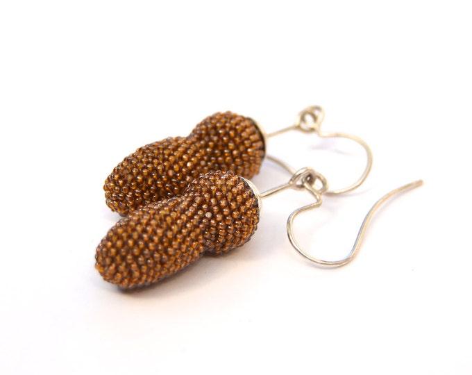 light brown beaded silver earrings caramel