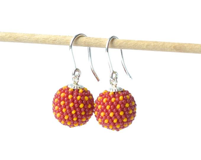globe earrings red- orange silver hooks