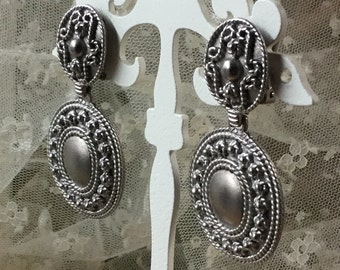 Etruscan Inspired Signed Made in USA Dangling Medallion Earrings Clip On Silver Tone Metal Highly Detailed Designer Cartouche Twisted Wire