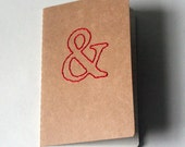 stitched moleskine notebook, red ampersand (lined pages)