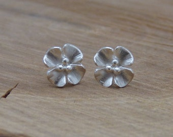 Small silver buttercup earring studs - oxidised and gold plated