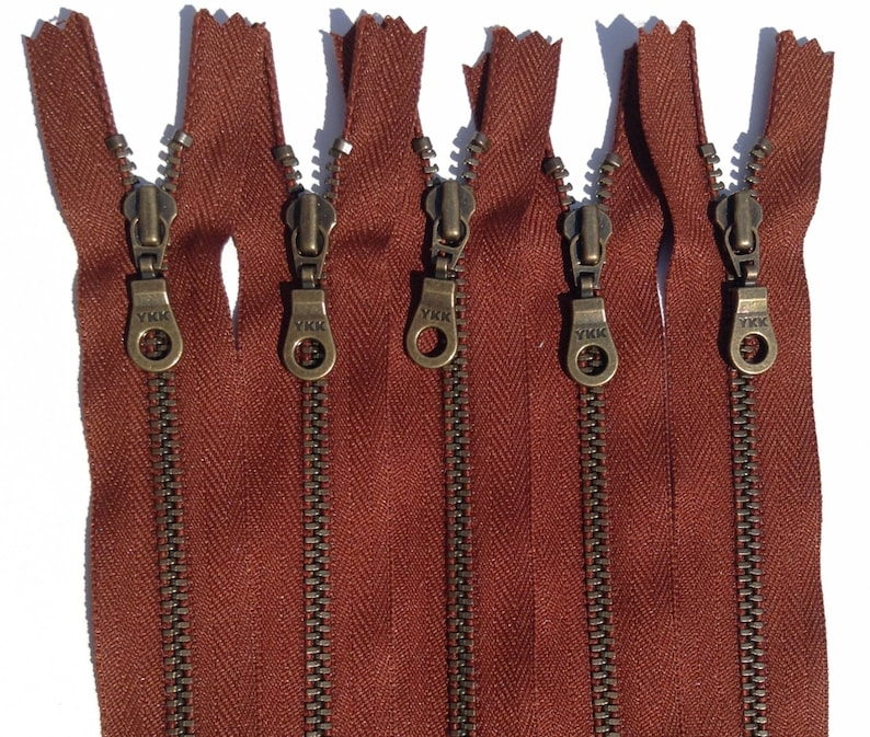 YKK Metal Teeth Zippers Rusty Red Brown Antique Brass Donut image 0
