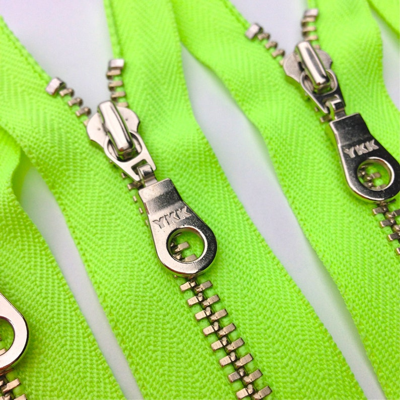 YKK metal zippers with silver nickel teeth and donut style image 0
