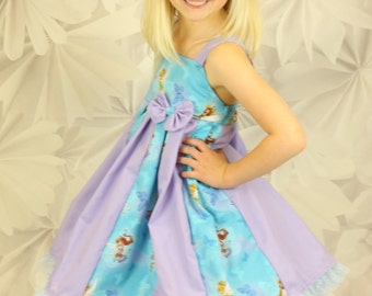 custom boutique dress made with tinkerbell fabric  size 2-6