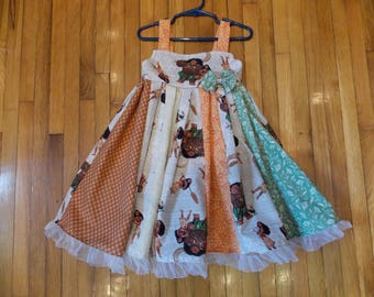 custom boutique dress made with Moana  fabric size 2-6