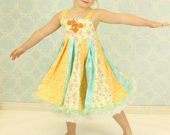 custom boutique dress made with nemo fabric size 2-6