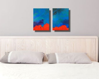 Two abstract modern contemporary paintings in vivid scarlet orange blue.