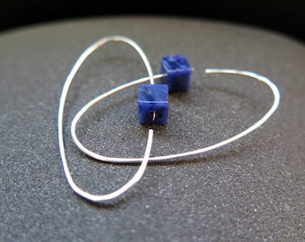 blue stone earrings. sodalite jewelry. modern hoops in sterling silver.