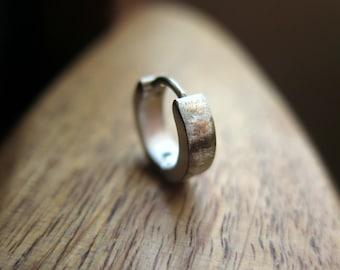 silver hoop earring for men. men's jewelry in brushed stainless steel.