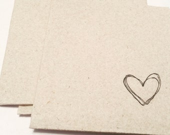 Beautifully simple!  Pack of 25 linen-like beverage napkins for your wedding or shower with hearts.