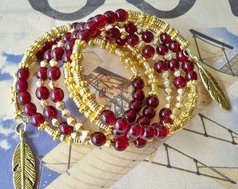 Garnet and Gold beaded Wrap Bracelet - Feather charms - FSU - Glass Garnet - Metal Gold - One size fits all - Handmade - bycat