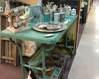 Turquoise metal pipe table