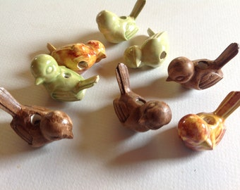 Eight ceramic birds