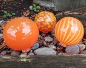 "Larger Orange Floats, Set of Three, 4"" - 5"" Glass Garden Balls in Various Bright Patterns, Decorative Spheres By Avalon Glassworks"