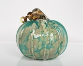 "Turquoise Blown Glass Pumpkin With Beige Spots, 4.5"" Decorative Gourd Sculpture with a Coiled Golden Metallic Stem, Avalon Glassworks"
