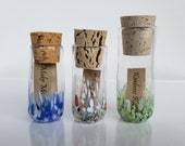 """Message Bottles, Set of Three, 4"""" Blown Glass Jars with Cork Stoppers, Brightly Colored, Each Holding a Little Note, by Avalon Glassworks"""