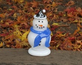 "Glass Snowman Sculpture with Black Hat and Blue Scarf, Black Eyes & Smile, ""Carrot"" Nose, By Avalon Glassworks"