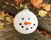 "Snowman Head Ornament, 4"" Round Blown Glass Holiday Frosty Hanging Ball, Black Glass ""Coal"" Eyes and Orange Carrot Nose, Avalon Glassworks"