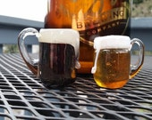 "Micro Brews. Set of Two Mini Beer Mug Sculptures, 2"" Tall Solid Glass Paperweights or Hanging Decorations, By Avalon Glassworks"