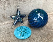 "Blue Sea Life and Float Set, Three-Piece Glass Sculpture Set Includes Sea Star, Sand Dollar and 4"" Deep Blue Float, By Avalon Glassworks"