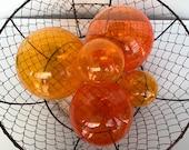 """Just Oranges, Set of Five, 2.5"""" - 4.5"""" Glass Garden Balls in Transparent Light & Dark Orange, Decorative Floating Spheres, Avalon Glassworks"""