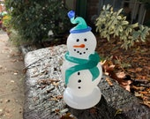 "Glass Snowman Sculpture with Teal Green Hat and Scarf, Blue Trim, Black Eyes & Smile, ""Carrot"" Nose, Holiday Mantel Decor, Avalon Glassworks"